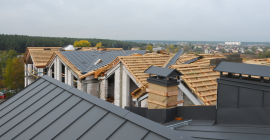 Pointed standing seam roofs on residential complex